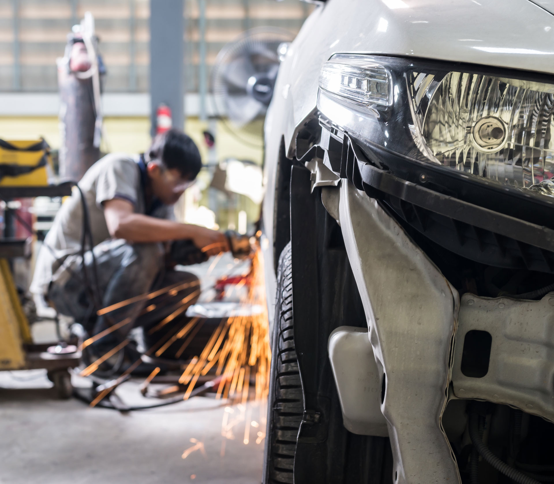 Experienced Technician repairing vehicle