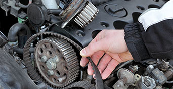 Man's hands repairing engine components